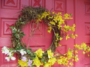 Silk ivy and flowers on a grapevine wreath for Easter, 2011.  By Woodland Gnome