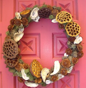 Grapevine wreath decorated with Lotus pods, Deodora Cedar cones, moss, and local oyster and clam shells.  Handmade by Woodland Gnome.