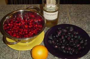 This photo was taken before I remembered my sack of muscadine grapes in the refrigerator.  I simply added a second orange to the mix to balance the grapes.