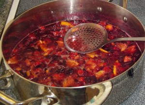 "Once the cranberries have all ""popped"", stir in the wine and spices."