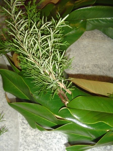 Make bundles of evergreen branches and secure each bundle to the base with a floral staple.