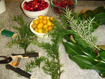 Floral wire, clippers, fruit and greens are all that is needed to make your wreath.