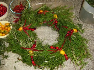 This finished evergreen wreath is ready to hang.