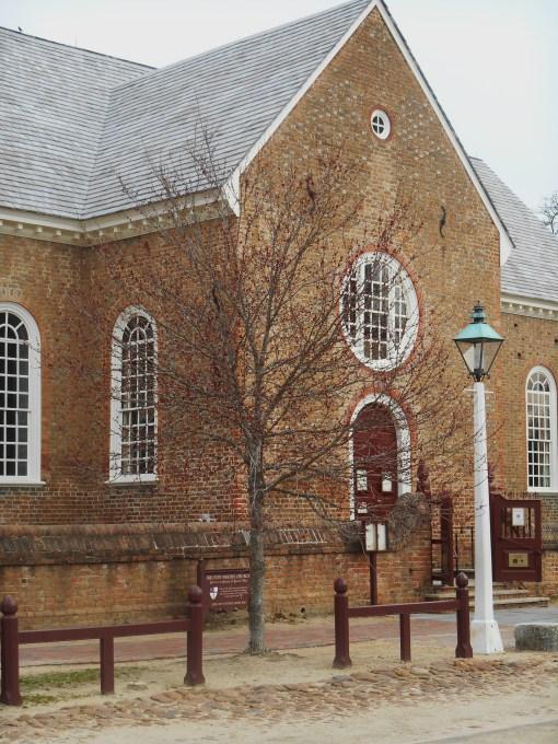 The main entrance to Bruton Parish, inside the church yard wall.