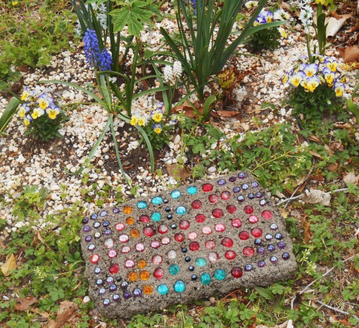 This hypertufa stepping stone made its debut in the garden today.