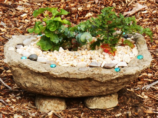 """A """"toad house"""" made from a hypertufa pot and its stand.  Little creatures will find a safe, cool hiding spot here on hot summer days."""
