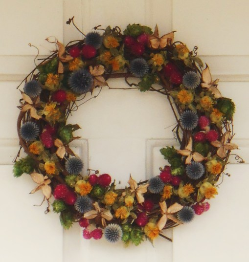 This lovely wreath features mostly dried flowers and seed pods.  You could make this easily with a hot glue gun.
