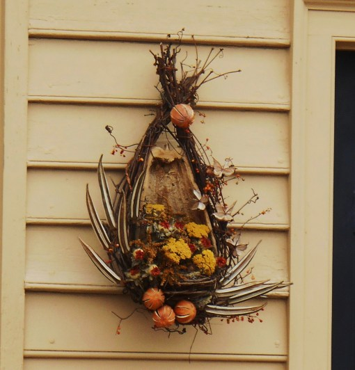 This wreath is formed on grapevines and a hollowed out gourd.