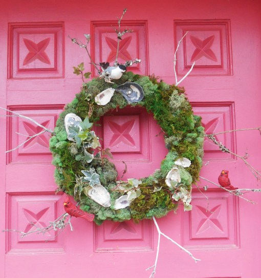 My front door this December, decorated with bits from our garden and wooden birds.